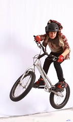 training wheels(0.0), extreme sport(0.0), stunt performer(0.0), mountain bike(1.0), bicycle motocross(1.0), vehicle(1.0), bmx bike(1.0), freestyle bmx(1.0), sports equipment(1.0), cycle sport(1.0), bicycle(1.0),