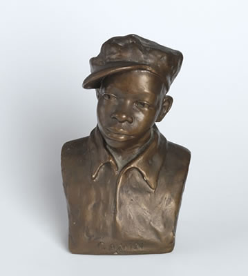 bronze bust sculpture of a young boy wearing a hat