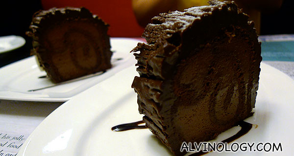 Two slices of chocolate log cake