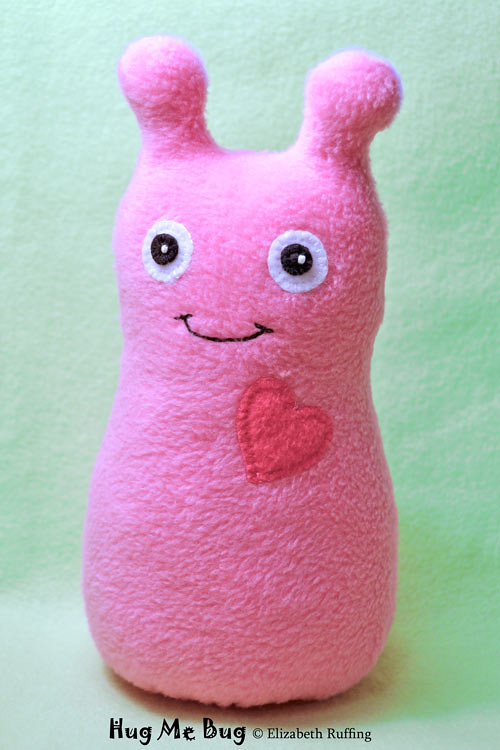 Pink fleece Hug Me Bug, original art toy by Elizabeth Ruffing