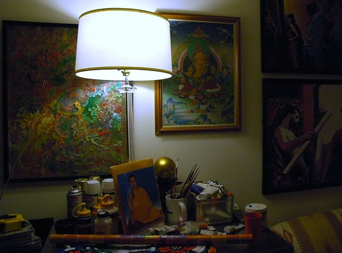 Painters table with lamp, paintings, formal Tibetan style photo of HE Dezhung Rinpoche the 4th, paint brushes, acrylic paint, sofa, Tibetan painting, Greenwood, Seattle, Washington, USA by Wonderlane