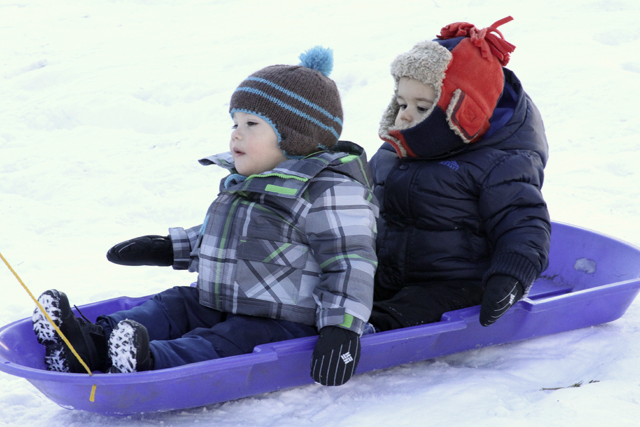 jc and damian on the sled