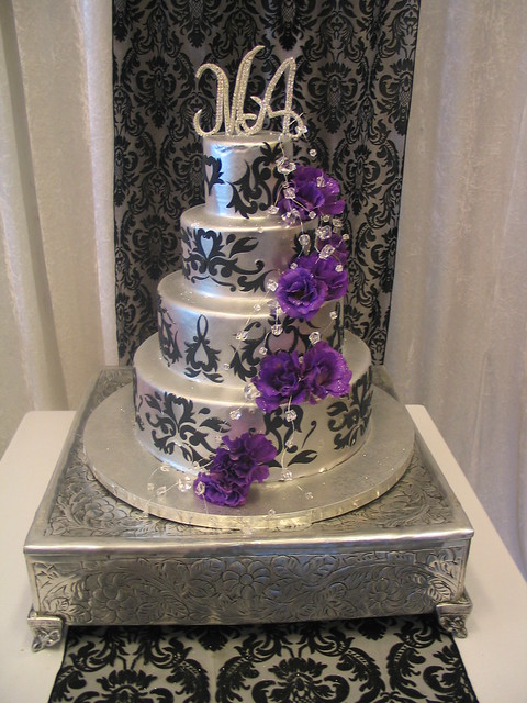 4 Tier Wicked Chocolate Wedding Cake Iced In Silver Chocolate Ganache Decorated With Black