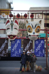 Souvenir picture with huge masks of fox.