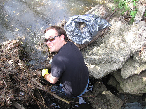 Working as an Earth Team volunteer, Cartographic Technician Jonathan Bowlin pulls trash from a stream near his office in Greensboro, N.C.