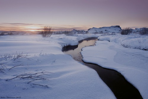 winter sunset snow reflection creek island iceland afternoon bushes heiðmörk rauðhólar