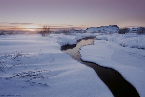 winter sunset snow reflection creek island iceland afternoon bushes heiðmörk rauðhólar
