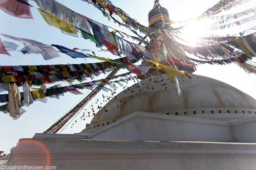 Stupa with prayer flags and birds