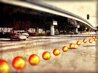 Gold Soccer balls under the overpass. Oakland California.