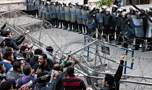 Egyptian confront police in the aftermath of clashes during a soccer game that killed 74 people. Protesters have blamed police for the deaths. by Pan-African News Wire File Photos