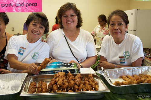 Happy vendors at a Filipino food booth at Kona Coffee Festival