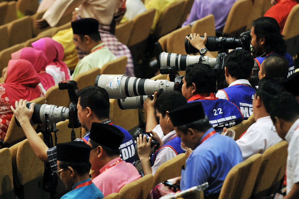 Image result for photojournalist at work