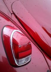 wheel(0.0), bumper(0.0), pink(0.0), automobile(1.0), automotive tail & brake light(1.0), automotive exterior(1.0), vehicle(1.0), red(1.0),