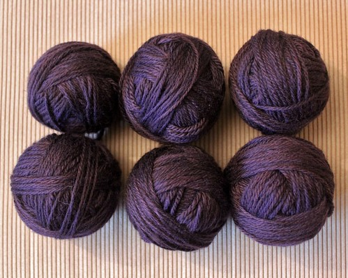 aubergine dyed balls of wool - after