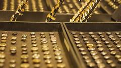 typewriter(0.0), office equipment(0.0), yellow(1.0), metal(1.0), macro photography(1.0), close-up(1.0), gold(1.0),