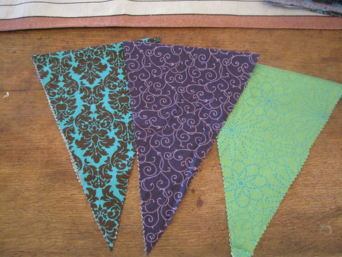 I used three different fabrics for my banners. I ended up cutting out 129 of the diamonds.