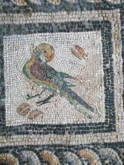 tapestry(0.0), pattern(0.0), textile(0.0), needlework(0.0), embroidery(0.0), flooring(0.0), art(1.0), mosaic(1.0),