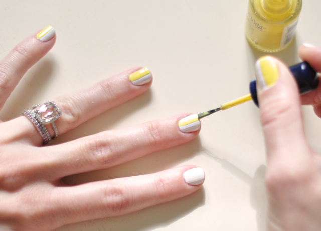 yellow and white and silver sporty manicure