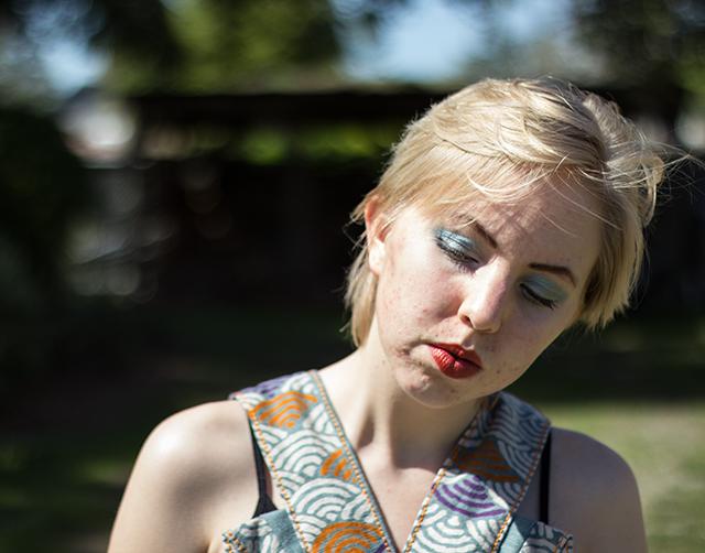 aqua blue eye makeup, copper lipstick