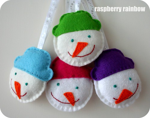 Four happy snow men all in a row.