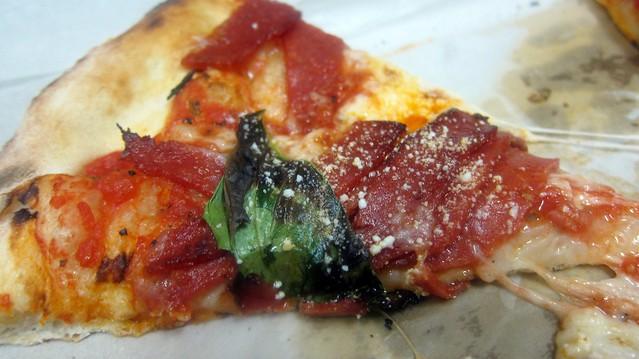 pizza slice at fuoco di napoli