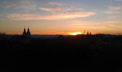 sunset steeple slovenia raka