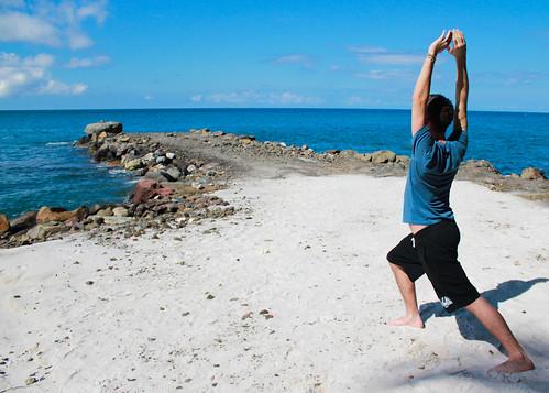 Morning yoga on the beach.