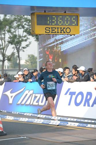 Crossing the finish line of the Shanghai Half Marathon 2011