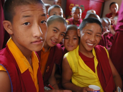 Young Tibetan boy monks in traditional robes, pose for a photo, side room, Sakya Lamdre, Tharlam Monastery of Tibetan Buddhism, Tharlam Monastery, Boudha, Kathmandu, Nepal by Wonderlane