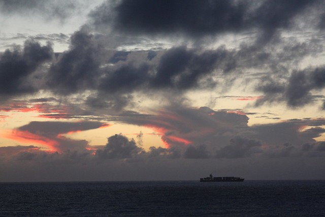 cargo ship at dusk, waikiki
