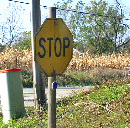 yellow stop sign