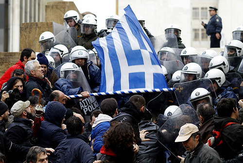 Riot Police clash with Greek protesters outside the Parliament building on February 7, 2012. The economic crisis in Greece has brought about the imposition of austerity. by Pan-African News Wire File Photos