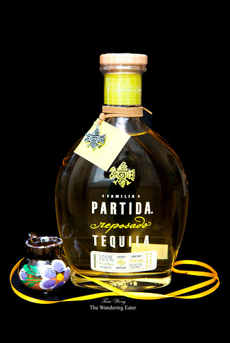 Partida Reposado Tequila with a traditional Mexican tequila cup