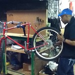 Wallace working on his bike.