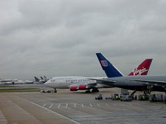airbus a380(0.0), takeoff(0.0), airline(1.0), boeing 777(1.0), aviation(1.0), airliner(1.0), airplane(1.0), airport apron(1.0), wing(1.0), vehicle(1.0), air travel(1.0), boeing 747(1.0), wide-body aircraft(1.0), infrastructure(1.0), boeing(1.0), tarmac(1.0), jet aircraft(1.0),