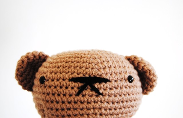Bowl Bear Amigurumi is looking at U
