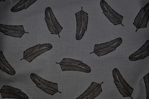 quill in black on dark grey