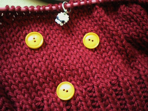 Yellow buttons on knitting