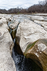 As the water flows the rock bends