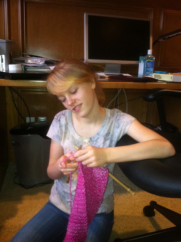 Zippy knitting her first project -- a scarf