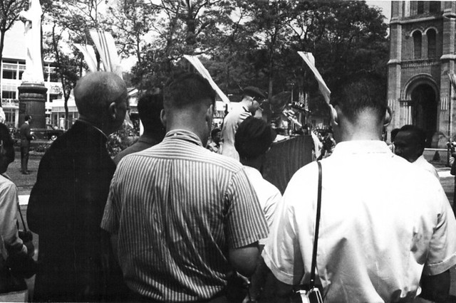 View from behind the press of a military official giving a speech
