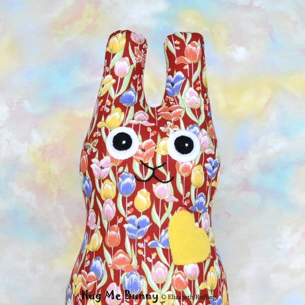 Red, orange, yellow, blue tulip print Hug Me Bunny rabbit art toy by Elizabeth Ruffing