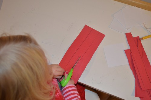 Cutting Paper Strips for Advent Countdown Chains (Photo from The Education of Ours)