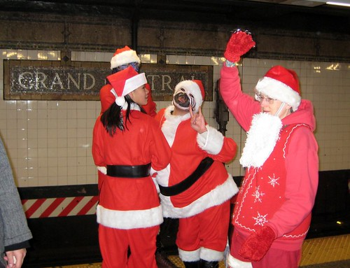 Santas rock the subway at Grand Central (by: Sam Berlin, creative commons license)