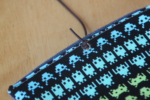 space invaders tobacco pouch.