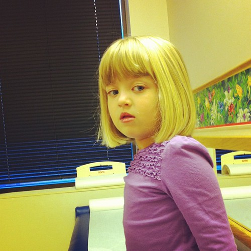 Poor feverish girl at the doctor. Not feeling good. Temp is 101.3.
