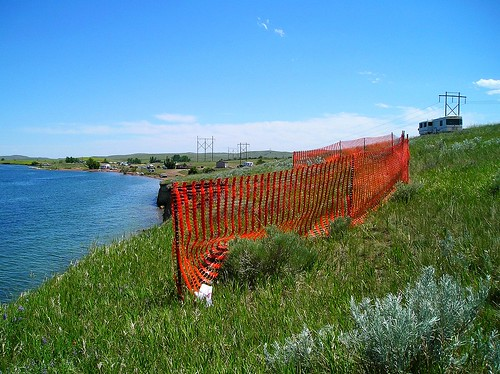 Warning Fence installed to prevent public from falling into large crevice that developed due to erosion on the west side of Lake DeSmet