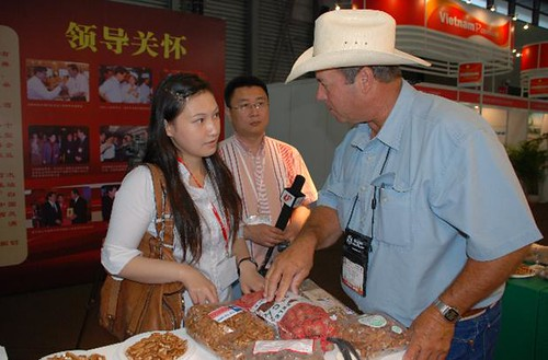 Tim Montz (right) of the Montz Pecan Company speaks with members of the Chinese media while displaying his Texas-grown products at the USDA-supported SIAL China food trade show in 2009. Participation in USDA events and export assistance from the Foreign Agricultural Service has helped international sales of Montz pecans thrive in recent years. Photo by Cindy Wise of the Texas Pecan Growers AssociationTim Montz (right) of the Montz Pecan Company speaks with members of the Chinese media while displaying his Texas-grown products at the USDA-supported SIAL China food trade show in 2009. Participation in USDA events and export assistance from the Foreign Agricultural Service has helped international sales of Montz pecans thrive in recent years. Photo by Cindy Wise of the Texas Pecan Growers Association
