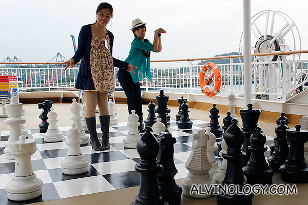 Silver and Mint, posing with the giant chess set