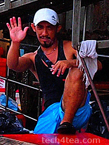 A local fish seller waving Selamat Pagi.